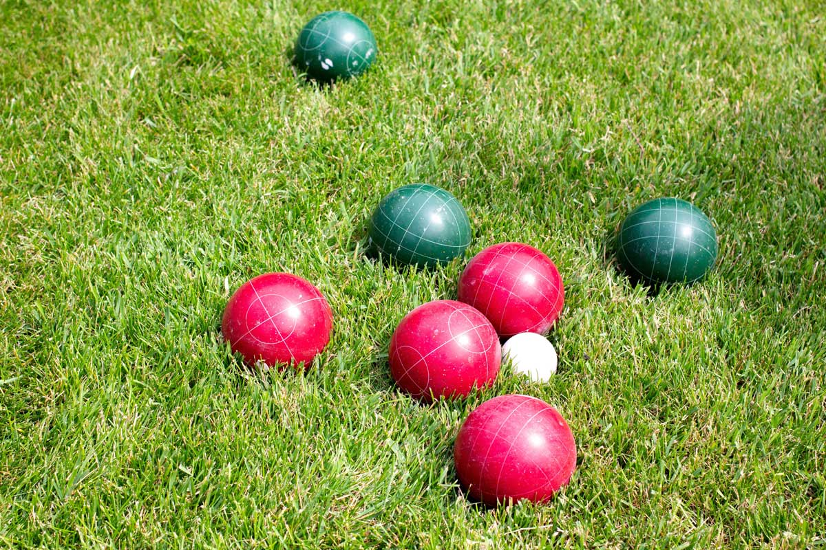 Bocce ball game with red and green balls.